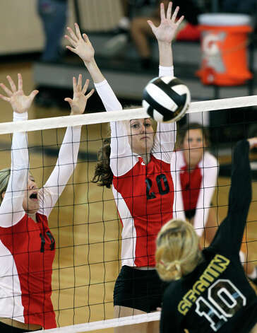Megan Isbell (20)  goes up for a block on Erin Moore as New Braunfels Canyon beats Seguin 3-0 at Steele High School gym on Tuesday, Aug. 14, 2012. Photo: Tom Reel, San Antonio Express-News / ©2012 San Antono Express-News