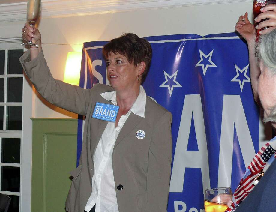 Democrat Sue Brand raises a glass of champagne to toast her supporters Tuesday night after easily beating Kevin Coyner in the Democratic primary for the 132nd legislative district. Photo: Genevieve Reilly / Fairfield Citizen