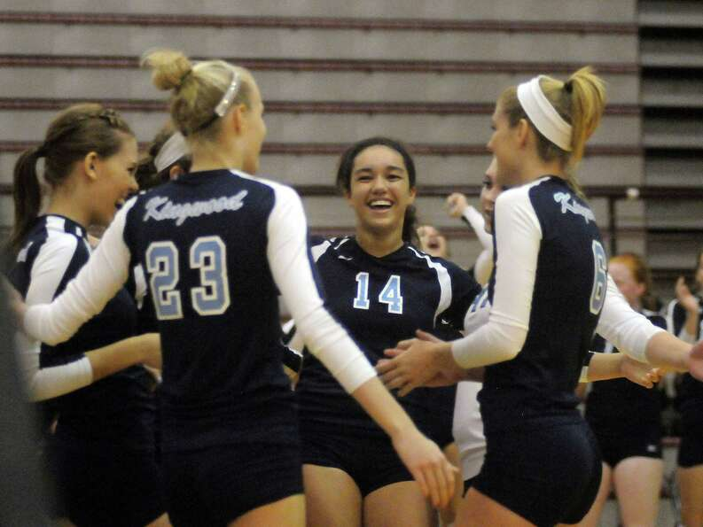 The Kingwood team including Cassidy Wheeler,center celebrate scoring a point over Stratford.