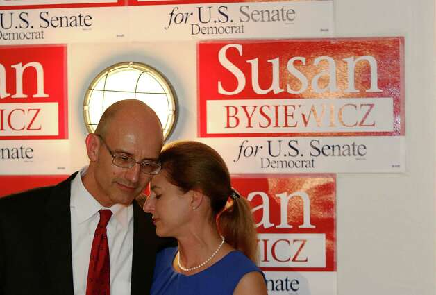 After losing the US Senate democratic Primary to Chris Murphy, Susan Bysiewicz shares a moment with her husand David Donaldson at the Mattabesett Canoe Club in Middletown, Conn on Tuesday Aug. 14, 2012. Murphy the will face Republican Linda McMahon in November. Photo: Mike Ross / Connecticut Post Freelance