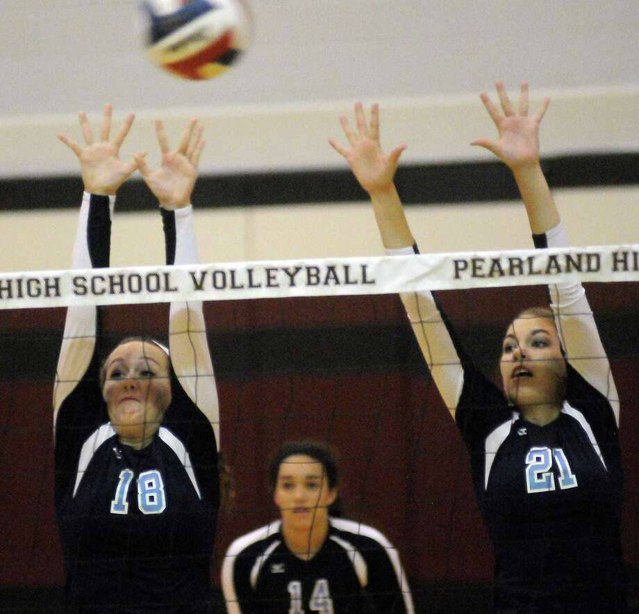 Kingwood's Neallie Payne and Tory Salness attempt a block against Stratford during their match. Photo: Dave Rossman, For The Houston Chronicle / © 2012 Dave Rossman