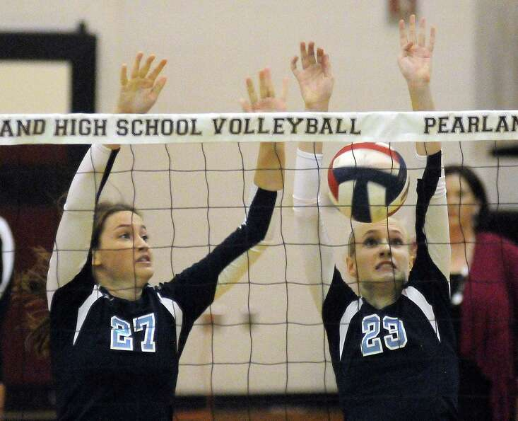 Brittney Howell and Madison McClurg of Kingwood attempt the block against Stratford.