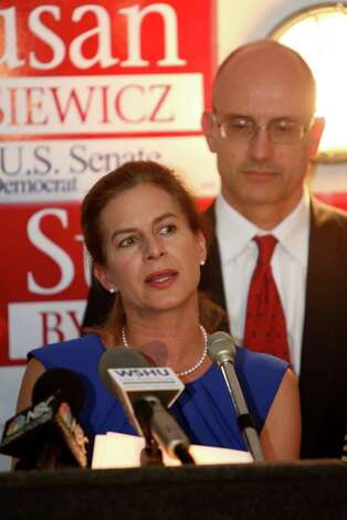 Mike Ross Connecticut Post freelance -Susan Bysiewicz gives her concession speech as husand David Donaldson looks on at the Mattabesett Canoe Club in Middletown, Conn on Tuesday Aug. 14, 2012. Bysiewicz lost the primary to Chris Murphy, the democratic candidate for US Senate to face Republican Linda McMahon in November. Photo: Mike Ross / Connecticut Post Freelance