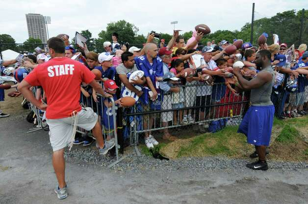 New York Giants defensive end Justin Tuck signs autographs at the end of practice on the last day of training camp at UAlbany on Tuesday Aug. 14, 2012 in Albany, NY.  (Philip Kamrass / Times Union) Photo: Philip Kamrass / 00018767C