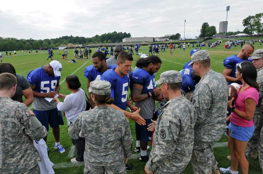 New York Giants players, including punter Steve Weatherford, center,  shake hands with and sign autographs for soldiers from West Point at the end of practice on the last day of training camp at UAlbany on Tuesday Aug. 14, 2012 in Albany, NY.  (Philip Kamrass / Times Union) Photo: Philip Kamrass / 00018767C