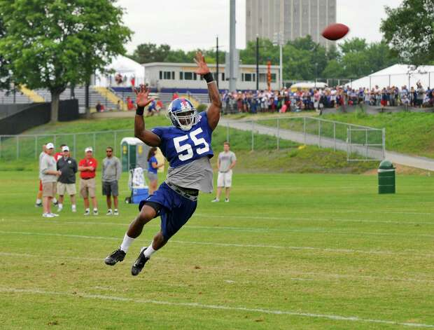 New York Giants linebacker Keith Rivers jumps for a high pass during practice on the last day of training camp at UAlbany on Tuesday Aug. 14, 2012 in Albany, NY.   (Philip Kamrass / Times Union) Photo: Philip Kamrass / 00018767C
