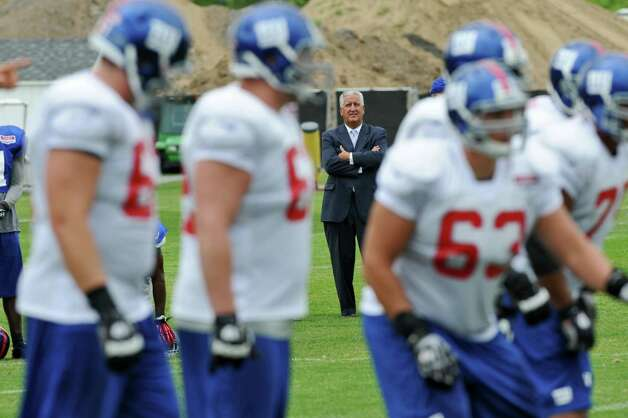 Albany Mayor Jerry Jennings watches New York Giants practice on the last day of training camp at UAlbany on Tuesday Aug. 14, 2012 in Albany, NY.   (Philip Kamrass / Times Union) Photo: Philip Kamrass / 00018767C