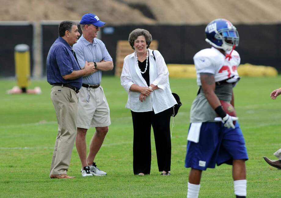UAlbany President George Philip, left, talks with New York Giants co owner John Mara, center, and former UAlbany President   Karen Hitchcock, right, on the last day of training camp at UAlbany on Tuesday Aug. 14, 2012 in Albany, NY.  (Philip Kamrass / Times Union) Photo: Philip  Kamrass / 00018767C