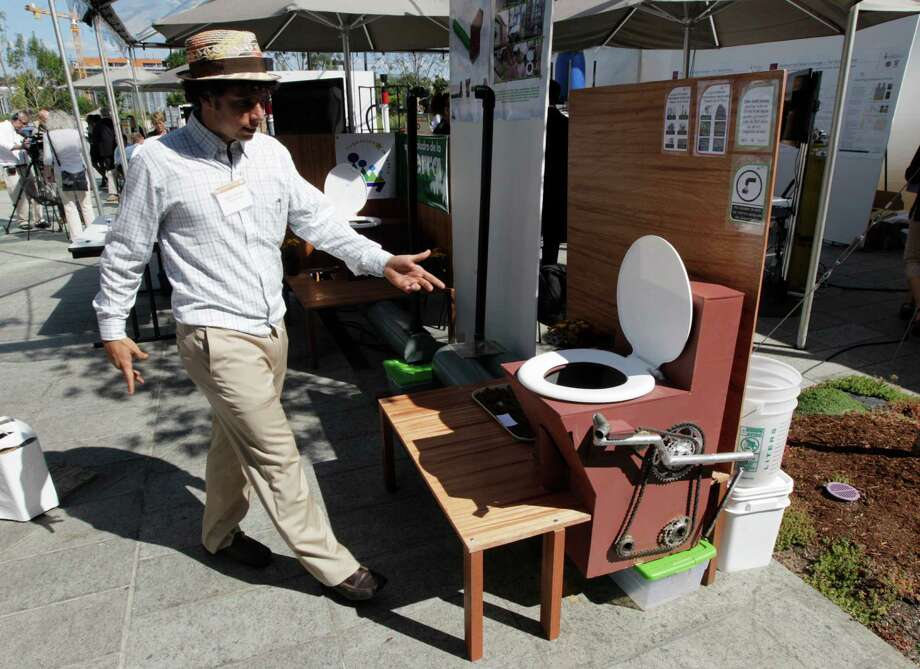 "Marcos Fiovavanti, of the Ecuador-based ""Fundacion In Terris"" group, talks about the ""Earth Auger Toliet,"" which is operated by a mechanical pedal and chain system, on display at the ""Reinventing the Toliet"" Fair, Tuesday, Aug. 14, 2012, in Seattle. The event is part of a Bill & Melinda Gates Foundation competition to reinvent the toilet for the 2.6 billion people around the world who don't have access to modern sanitation. Photo: Ted S. Warren, Associated Press / AP"
