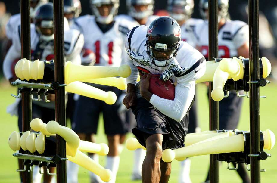 Receiver Andre Johnson, who missed the Texans' preseason opener last weekend, went through drills Tuesday and hopes to play against San Francisco on Saturday. Photo: Brett Coomer / © 2012 Houston Chronicle