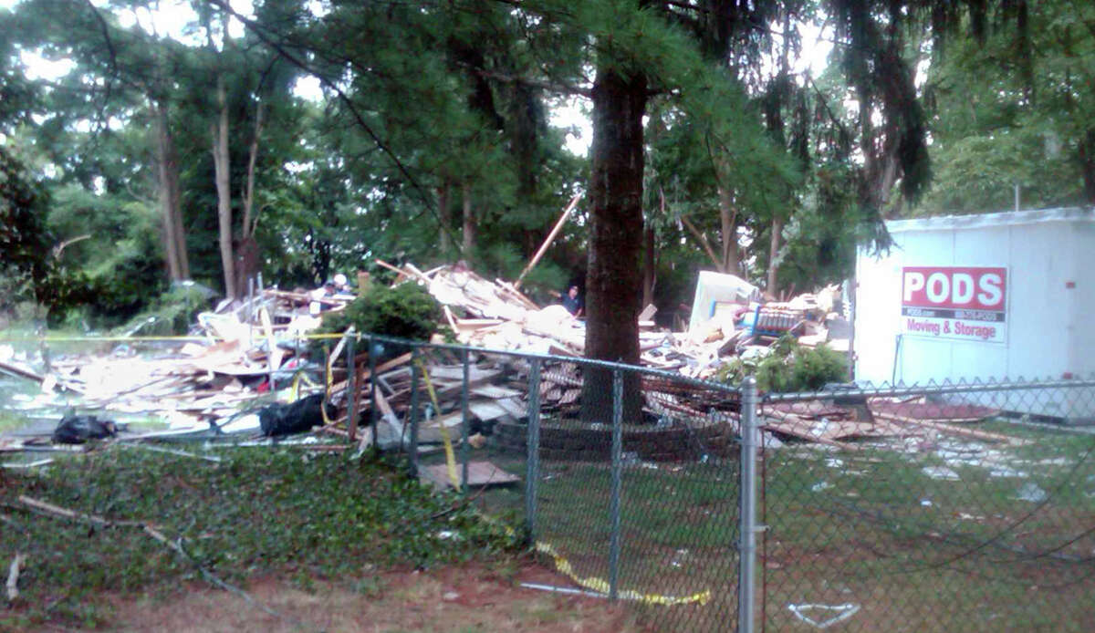A pile of wood, plywood, drywall, insulation and other building material is all that remains after an apparent gas-related explosion leveled a house in Brentwood, N.Y., Tuesday, Aug. 14, 2012. The blast killed a toddler and sent 14 other people to area hospitals. (AP Photo/Frank Eltman)