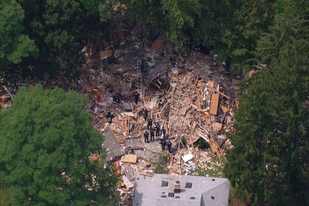 This image taken from video provided by News 12 Long Island shows the wreckage of a house that was destroyed by an apparent gas-related explosion, killing a toddler and sending 14 other people to hospitals, in the Long Island town of Brentwood, N.Y., Tuesday, Aug. 14, 2012. The entire structure of the house, situated on a block of well-kept, modest homes, was reduced to small shards of wood, plywood, drywall, insulation and other building material. (AP Photo/News 12 Long Island) MANDATORY CREDIT