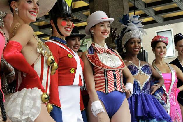 "Members of the Rockettes pose for photographers in front of Radio City Music Hall in New York Tuesday, Aug. 14, 2012. They were part of Radio City's ""Christmas in August"" annual event promoting and previewing the annual Christmas Spectacular show and celebrating 85 years of the Rockettes performing in New York. (AP Photo/Alex Katz) Photo: ALEX KATZ"