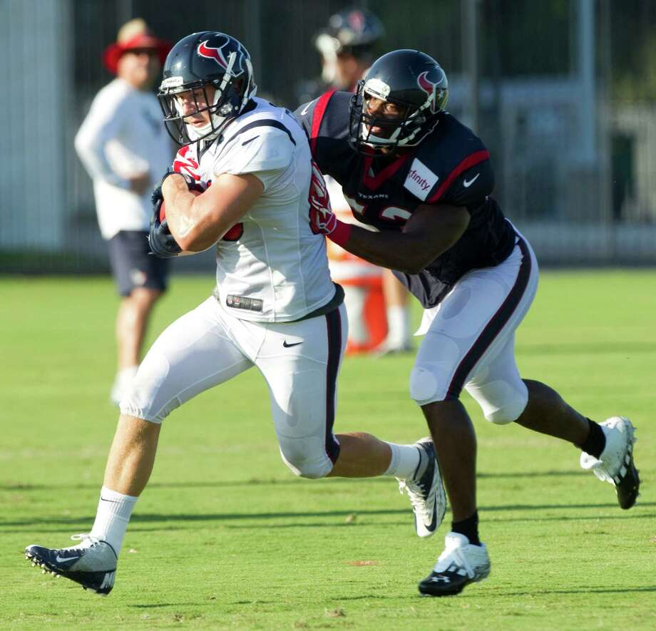 Texans tight end Garrett Graham, left, long relegated primarily to scout-team duties, is trying to claim the opening left by Joel Dreessen's exit via free agency. Photo: Brett Coomer / © 2012 Houston Chronicle