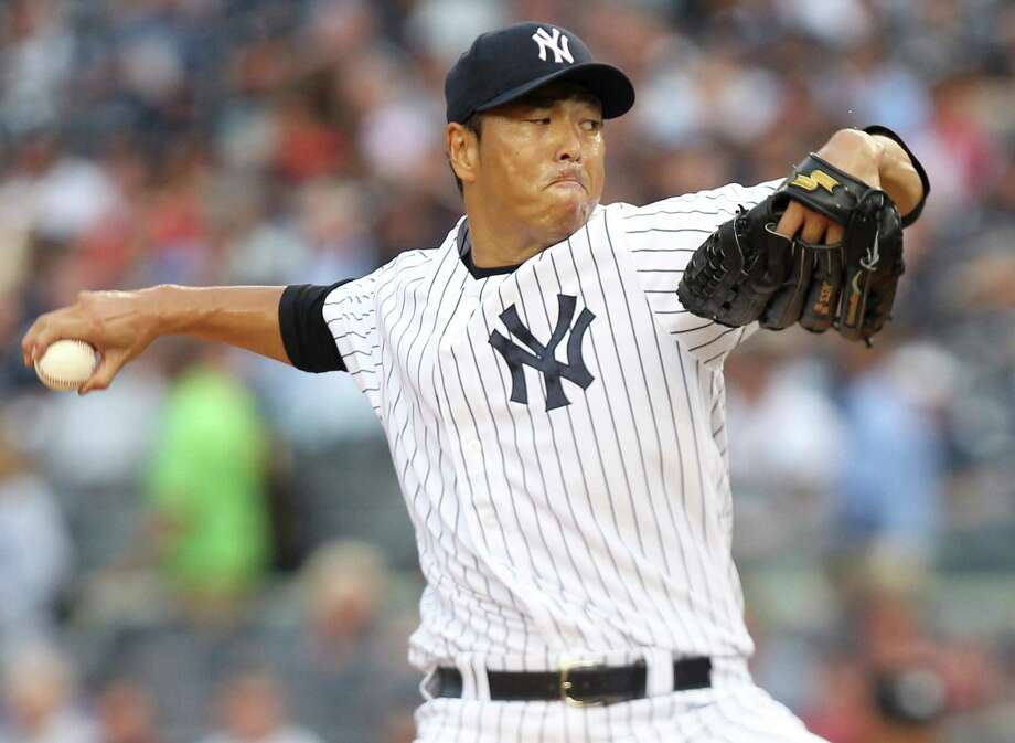 Hiroki Kuroda was all business in going the distance and shutting down the Rangers on two hits in a 3-0 victory Tuesday night at Yankee Stadium. Photo: Seth Wenig / AP