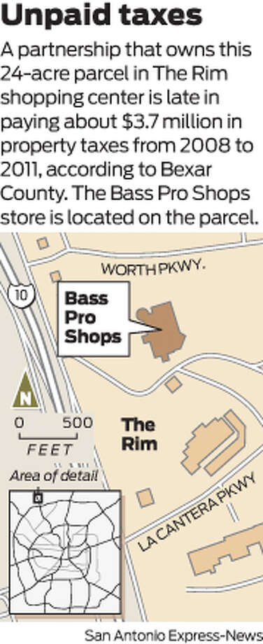 A partnership that owns this 24-acre parcel in The Rim shopping center is late in paying about $3.7 million in property taxes from 2008 to 2011, according to Bexar County. The Bass Pro Shops store is located on the parcel.