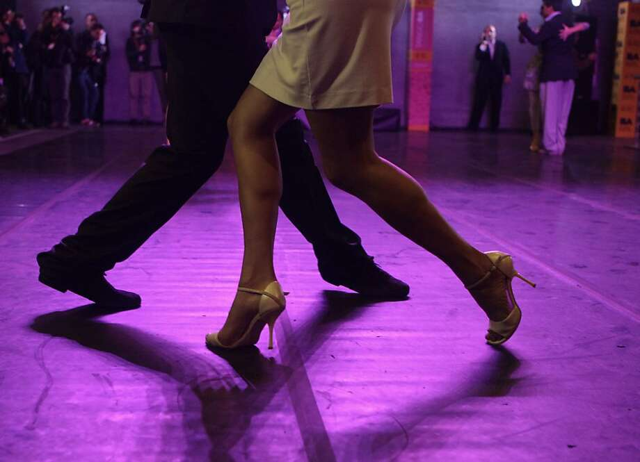 A couple dances during the opening day of the annual festival and championship in Buenos Aires, Argentina, Tuesday, Aug. 14, 2012. The two-week long event offers more than 500 free dance lessons, concerts and recitals. Hundreds of professional dancers will compete in the championship and teach many the eight basic steps of the dance in the city where it was born. Photo: Eduardo Di Baia, Associated Press