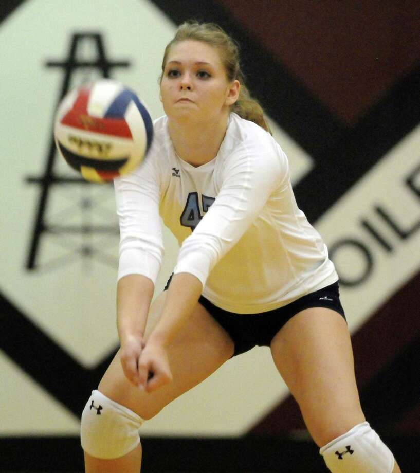 Kate Cegelski of Kingwood sets up a return during the Mustangs' four-set victory over Stratford in the team's season-opening volleyball matches Tuesday night. Photo: Dave Rossman / © 2012 Dave Rossman