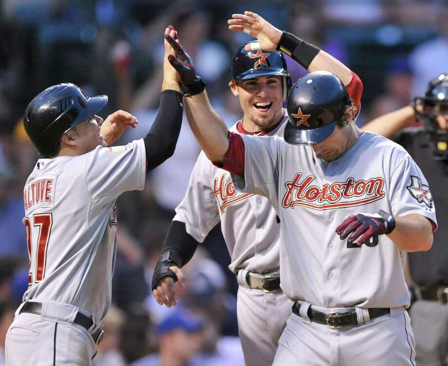Teammates Jose Altuve, left, and Tyler Greene help Brett Wallace, right, celebrate his third-inning, three-run homer that gave the Astros an early boost. Photo: PAUL BEATY / FR36811 AP