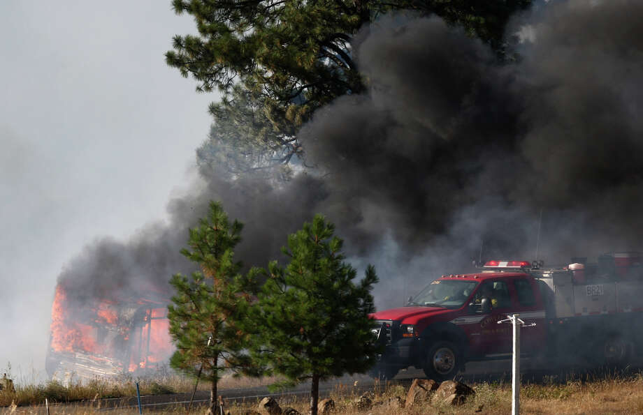 Firefighters try to hold a line as trailer erupts in flame. Photo: JOSHUA TRUJILLO / SEATTLEPI.COM