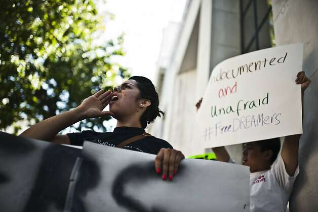 Blanca Vazquez, left, protests with the DREAMers during President Obama's visit to Oakland on Monday, July 23 in Oakland, Calif. Photo: Yue Wu, The Chronicle