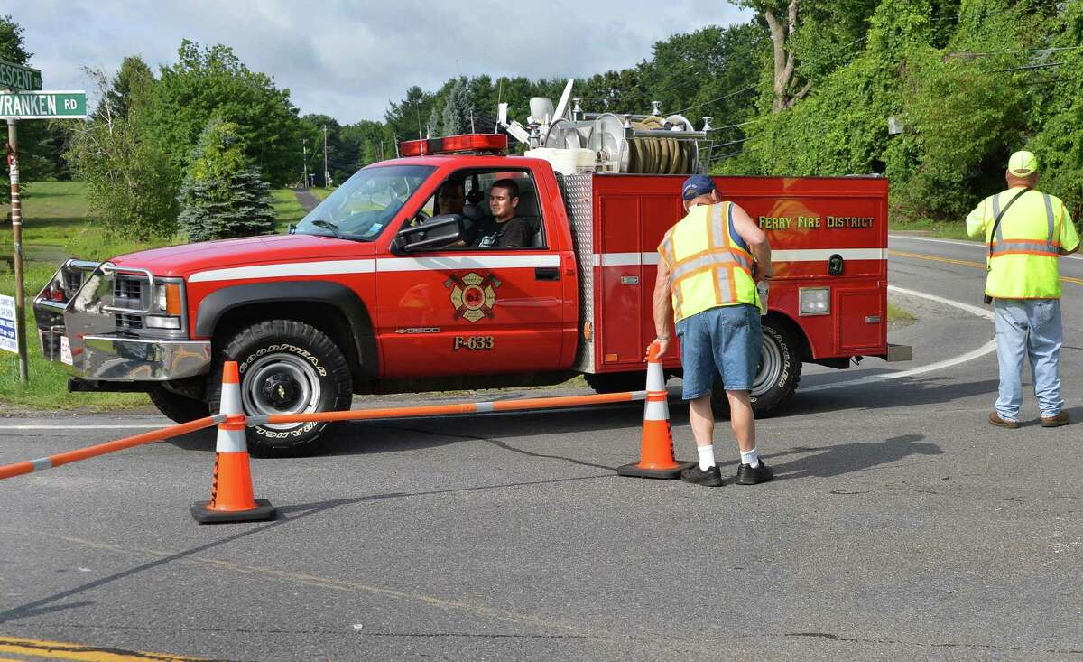 A Vischer Ferry fire truck enters Van Vranken Rd. on route to a fatal airplane accident in Clifton Park Wednesday Aug. 15, 2012.(John Carl D'Annibale / Times Union)