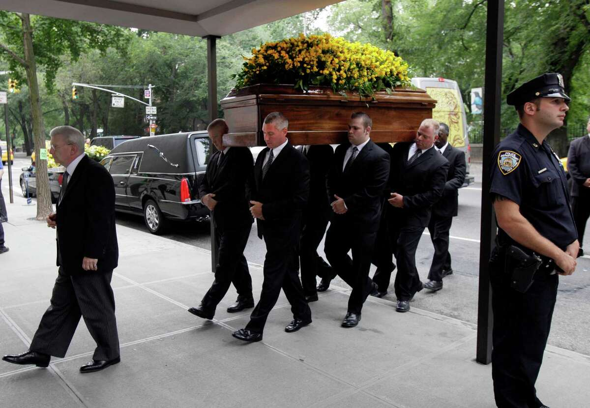"""Pallbearers carry the casket of Marvin Hamlisch into New York's Temple Emanu-El for his funeral, Tuesday, Aug. 14, 2012. Hamlisch composed or arranged hundreds of scores for musicals and movies, including """"A Chorus Line"""" on Broadway and the films """"The Sting,"""" ''Sophie's Choice,"""" ''Ordinary People"""" and """"The Way We Were."""" He won three Oscars, four Emmys, four Grammys, a Tony, a Pulitzer and three Golden Globes. Hamlisch died Aug. 6 in Los Angeles at age 68."""