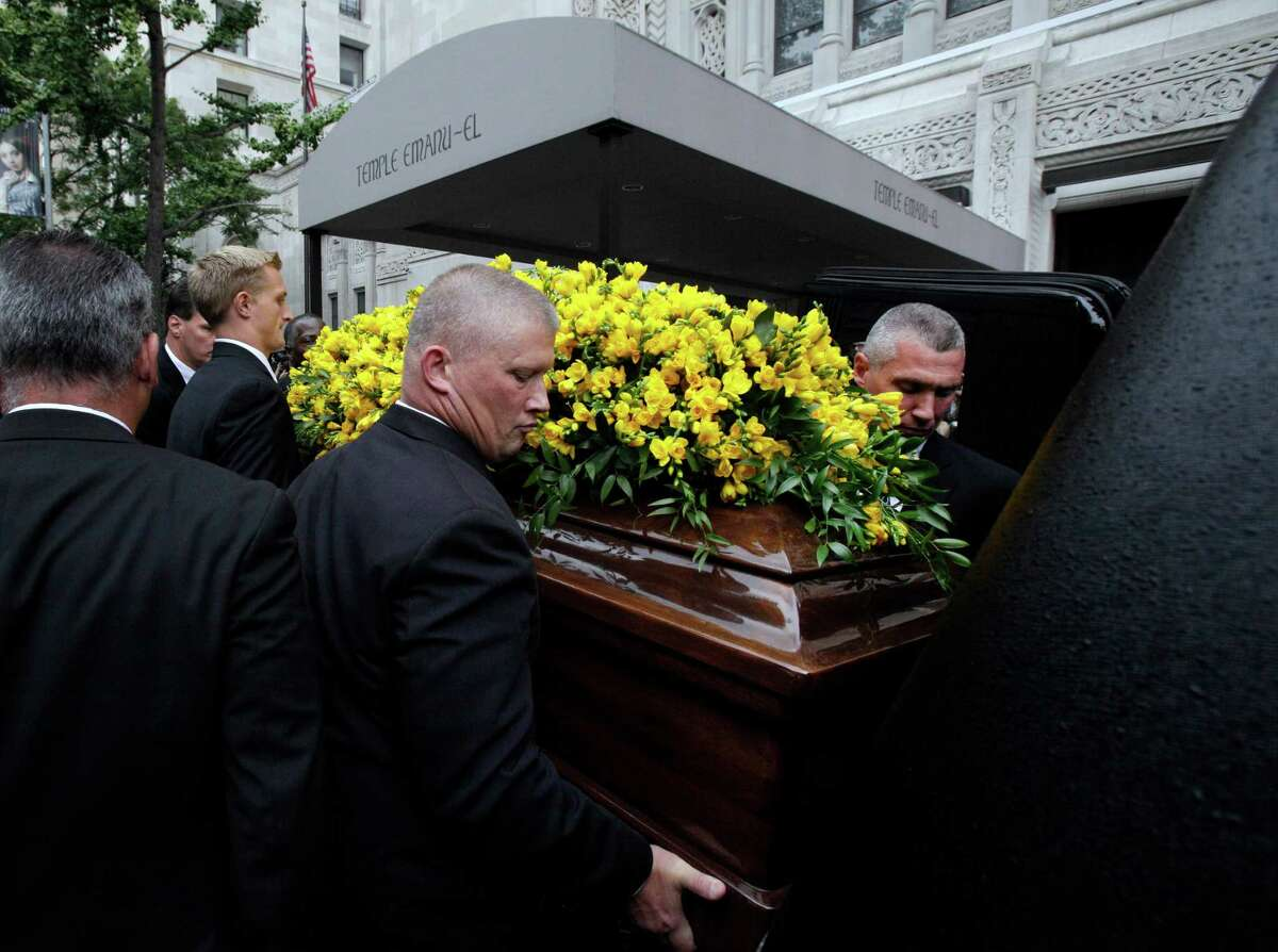 """Pallbearers place the casket of Marvin Hamlisch in the hearse after his funeral service, in New York's Temple Emanu-El, Tuesday, Aug. 14, 2012. Hamlisch composed or arranged hundreds of scores for musicals and movies, including """"A Chorus Line"""" on Broadway and the films """"The Sting,"""" ''Sophie's Choice,"""" ''Ordinary People"""" and """"The Way We Were."""" He won three Oscars, four Emmys, four Grammys, a Tony, a Pulitzer and three Golden Globes. Hamlisch died Aug. 6 in Los Angeles at age 68."""