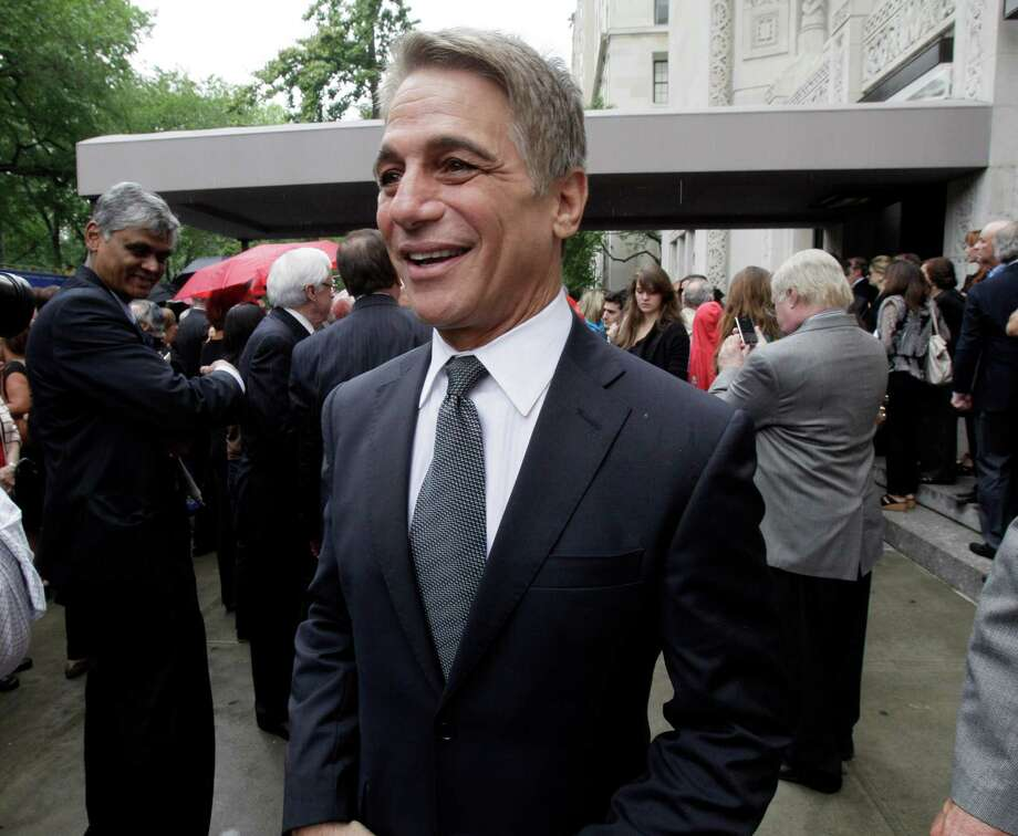 "Actor Tony Danza arrives for the funeral of Marvin Hamlisch, in New York's Temple Emanu-El, Tuesday, Aug. 14, 2012. Hamlisch composed or arranged hundreds of scores for musicals and movies, including ""A Chorus Line"" on Broadway and the films ""The Sting,"" ''Sophie's Choice,"" ''Ordinary People"" and ""The Way We Were."" He won three Oscars, four Emmys, four Grammys, a Tony, a Pulitzer and three Golden Globes. Hamlisch died Aug. 6 in Los Angeles at age 68. Photo: Richard Drew, AP / AP"
