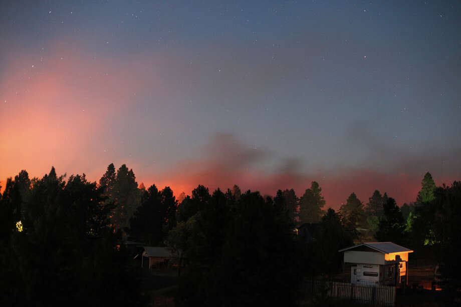 The orange glow of flames creeps closer to homes in the Sunlight Waters housing development as the Taylor Bridge wildfire advances on the community Tuesday night, August 14, 2012 near Cle Elum. Photo: JOSHUA TRUJILLO / SEATTLEPI.COM