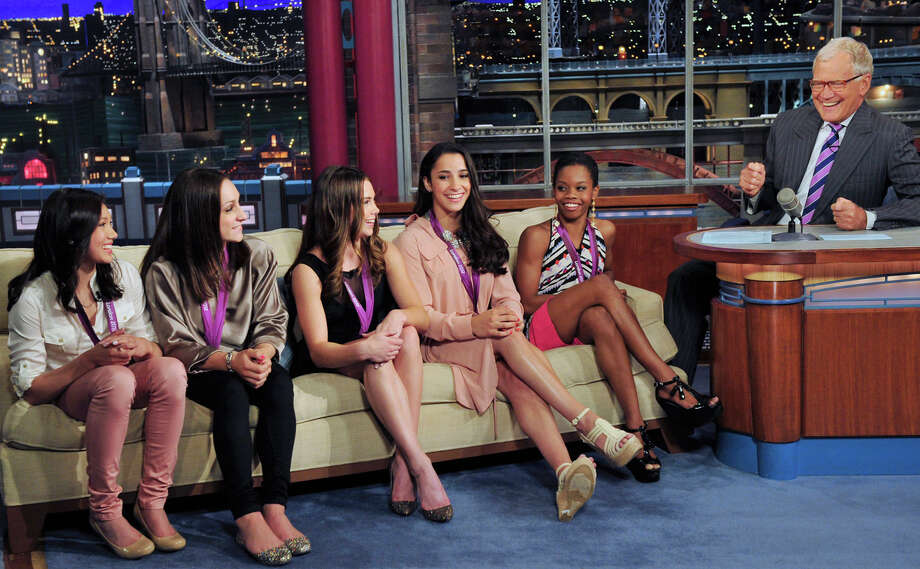 "In this photo provided by CBS, from left, Kyla Ross, Jordyn Wieber, McKayla Maroney, Aly Raisman and Gabby Douglas, members of the United States women's Olympic gymnastics gold medal-winning team, join television show host David Letterman on the set of the ""Late Show with David Letterman,"" Tuesday, Aug. 14, 2012, in New York. (AP Photo/CBS, John Paul Filo) MANDATORY CREDIT; NO SALES; NO ARCHIVE; FOR NORTH AMERICAN USE ONLY Photo: John Paul Filo, AP / CBST"