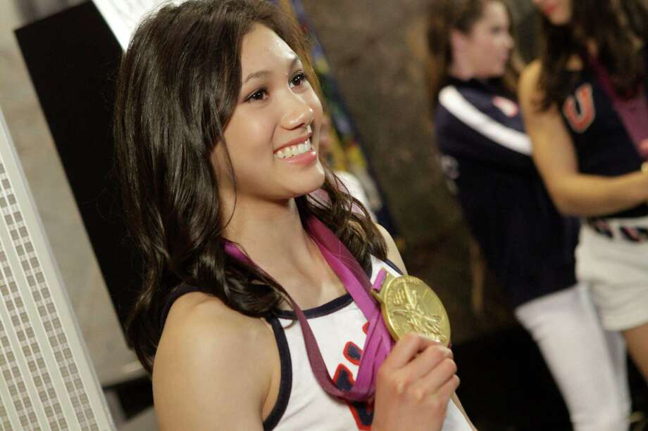 U.S. Women's Gymnastics Olympic team gold-medal winner Kyla Ross poses with her medal at the Empire State Building, Tuesday, Aug. 14, 2012 in New York. Photo: Alex Katz, AP / AP