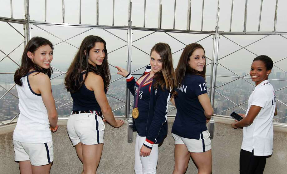 Members of the 2012 US Women's Gymnastics Olympic Team, from left, Kyla Ross, Aly Raisman, McKayla Maroney, Jordyn Wieber and Gabby Douglas pose on the observation deck of the Empire State Building, Tuesday, Aug. 14, 2012 in New York. Photo: Jason DeCrow, JASON DECROW/INVISION/AP / Invision