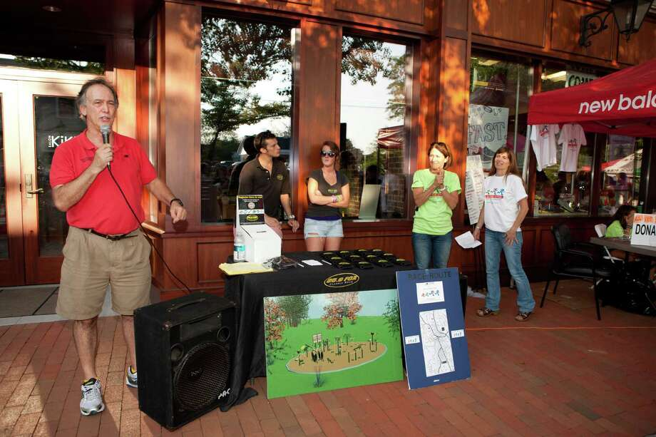 Ron Rosenfeld of New Balance on Main Street addresses the crowd during last year's All Out for Autism 5K. This year's event takes place at 6 p.m. Friday, Aug. 24, 2012.  Photo courtesy of Phil Nelson Photo: Contributed Photo