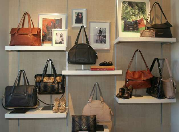 Elaine Turner's new Alamo Heights boutique features handbags inspired by her muse for fall, 1970s movie icon Ali MacGraw. Photo: Julysa Sosa, San Antonio Express-News / SAN ANTONIO EXPRESS-NEWS