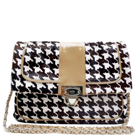 """Ryan"" bag in houndstooth haircalf with nude patent trim, $395 Photo: Elaine Turner, Courtesy"