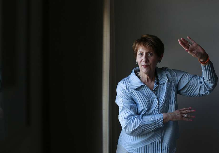 "Lynne Raider, 69, in her home on Friday Aug. 10, 2012 in San Francisco, Calif., has been participating in a dance class with other Parkinson's disease patients for the past two years. Once a month she and 18-20 people living with the disease dance together. She said the benefits have been amazing. ""It has lightened my mind and given me another tool to help manage this disease,"" said Raider. Photo: Mike Kepka, The Chronicle"