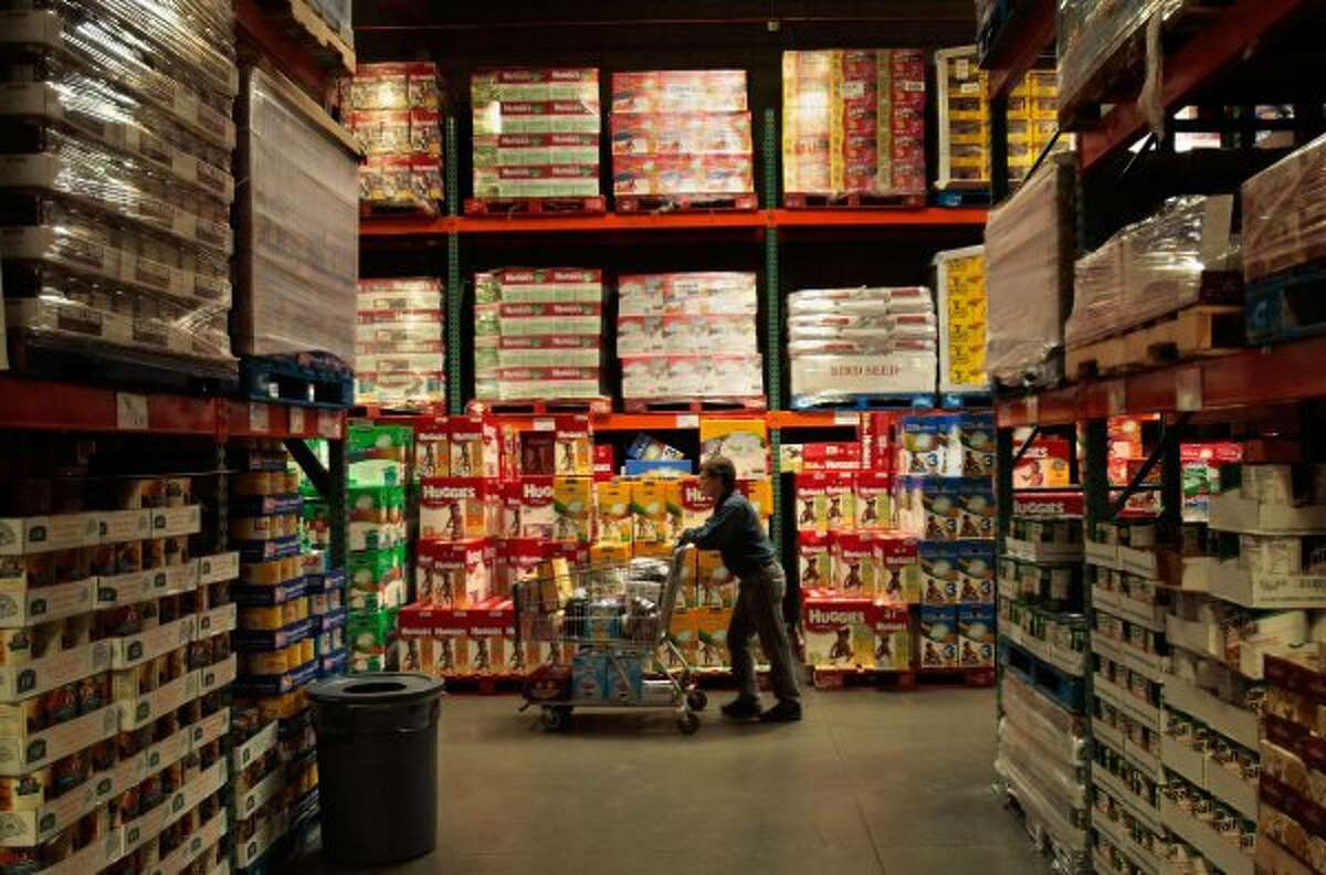 About 3 million people shop at Costco a day, where the merchandise changes frequently and aisles are purposely unlabelled. (So it feels more like a treasure hunt?). Keep clicking for archive photos that show how Crossgates looked when it first opened. (Chris Hondros / Getty Images)
