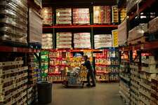 About 3 million people shop at Costco a day, where the merchandise changes frequently and aisles are purposely unlabelled. (So it feels more like a treasure hunt?) (Chris Hondros / Getty Images)
