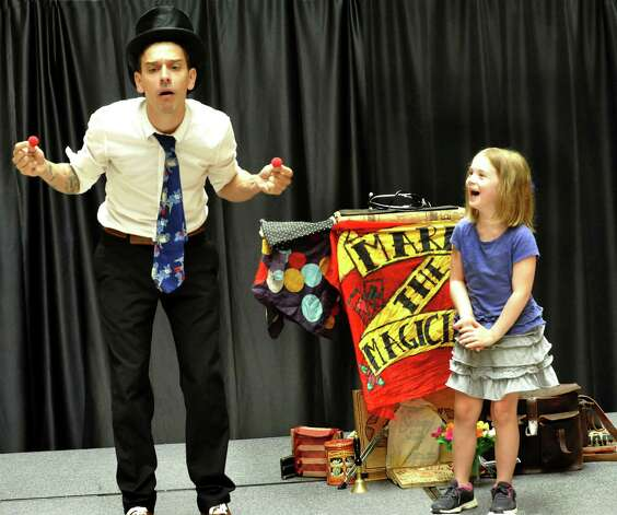 Mario the Magician performs his Amazing Magic Show to the delight of audience members including Madison Luchsinger, 6, of Danbury, during Danbury Kidz Camp at the Danbury Fair mall Tuesday, Aug. 14, 2012. Photo: Michael Duffy
