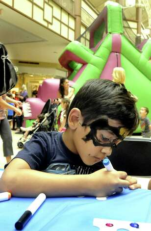 Abhiram Pathri, 5, of Danbury, works on his magic color scrach crown during Danbury Kidz Camp at the Danbury Fair mall Tuesday, Aug. 14, 2012. Photo: Michael Duffy