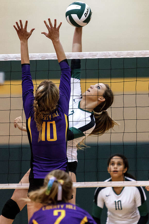 Canyon Lake's Amber Ramsey goes up for a kill over Liberty Hill's Kallie Perrin during their season opening three-team tournament with Liberty Hill and Clemens at Canyon Lake on Aug. 14, 2012 .  Photo by Marvin Pfeiffer / Prime Time Newspapers Photo: MARVIN PFEIFFER, Marvin Pfeiffer / Prime Time New / Prime Time Newspapers 2012