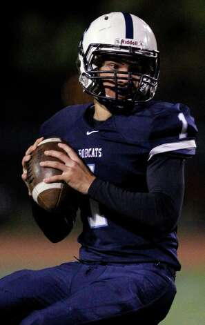 FOR SPORTS - South San's Justin Martinez looks to pass during game action against Highlands at the South San High School football stadium on Friday, Oct. 28, 2011. Highlands entered the game with a 29-game losing streak. South San won 35-28. MICHAEL MILLER / mmiller@express-news.net Photo: MICHAEL MILLER, SAN ANTONIO EXPRESS-NEWS / mmiller@express-news.net