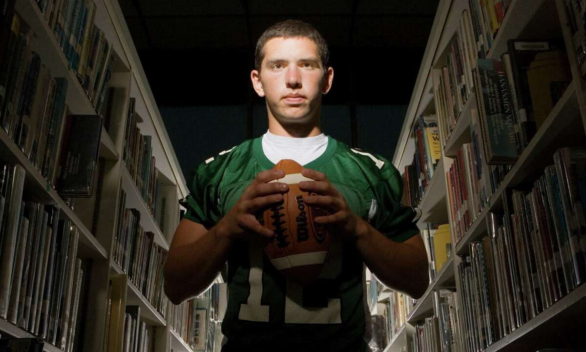 Senior quarterback Andrew Luck poses for a portrait in the Statford H.S. library in August 2007. Click through the gallery to see photos of Luck through the years.