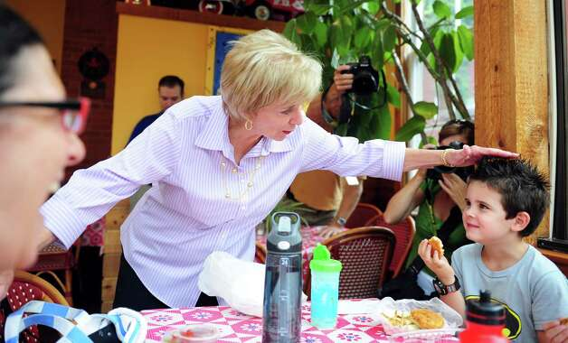 Republican Senate nominee Linda McMahon tests the limits of five-year-old Ethan Tavolacci's hair gel as he eats lunch at Firehouse Deli in Fairfield Wednesday, August 15, 2012.  Tavolacci was visiting from East Setauket, NY. Photo: Autumn Driscoll / Connecticut Post