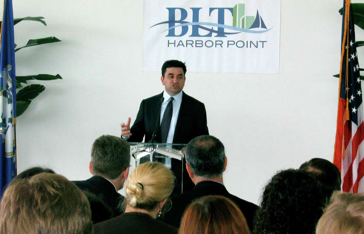 Greg Jensen, co-chief executive of Bridgewater Associates, announces a deal to move the hedge fund from Westport to Stamford and add up to 1,000 jobs in a press conference on Wednesday August 15, 2012, with Conn. Gov. Dannel P. Malloy.