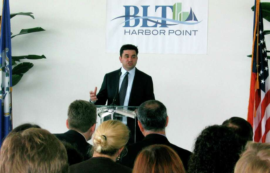 Greg Jensen, co-chief executive of Bridgewater Associates, announces a deal to move the hedge fund from Westport to Stamford and add up to 1,000 jobs in a press conference on Wednesday August 15, 2012, with Conn. Gov. Dannel P. Malloy. Photo: Olivia Just / Stamford Advocate