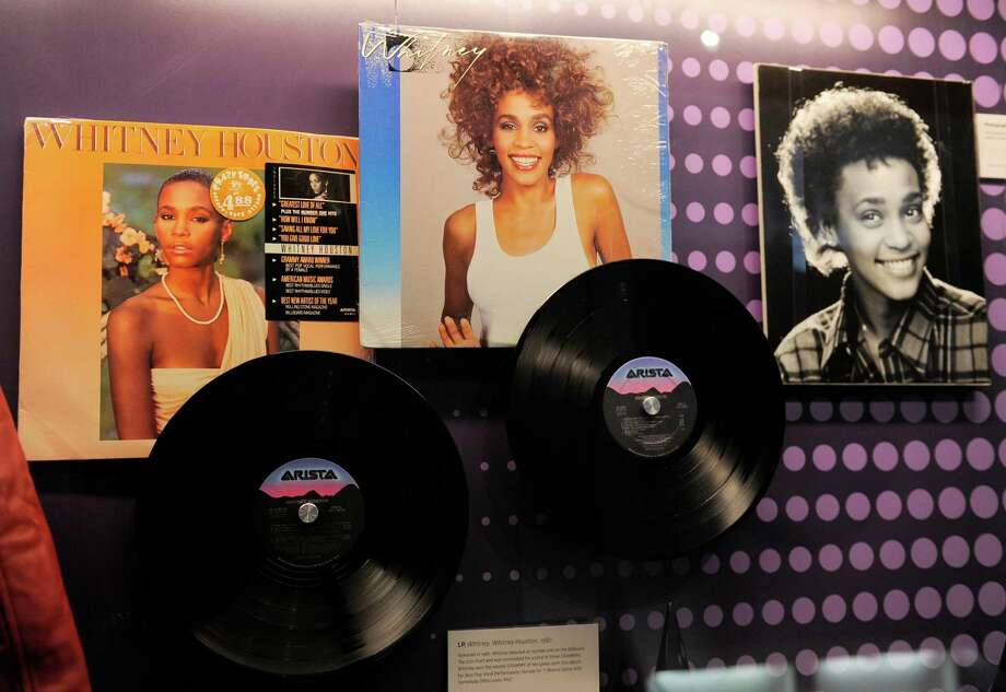 "Records by the late singer Whitney Houston are displayed at the media preview day for the ""Whitney! Celebrating the Musical Legend of Whitney Houston"" exhibit at The Grammy Museum on Wednesday, Aug. 15, 2012, in Los Angeles. (Photo by Chris Pizzello/Invision/AP) Photo: Chris Pizzello, Associated Press / Invision"