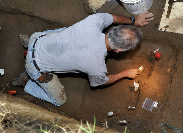 Connecticut State archaeologist Nick Bellantoni works in the gravesite of Albert Afraid of Hawk, a Sioux, who performed with the Buffalo Bill Wild West Show and died in Danbury in 1900. Photo: Carol Kaliff