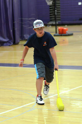 Nicholas Otis, 11, of Stamford, plays indoor hockey during Peak Performance All Sports Camp at Westhill High School in Stamford on Wednesday, Aug. 15, 2012. The camp offers a combination of traditional sports games, physical education activities, and cooperative games for boys and girls ages 4-12. Photo: Amy Mortensen / Connecticut Post Freelance